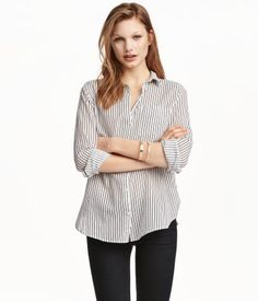 White/black striped. Long-sleeved shirt in airy cotton fabric with a chest pocket and rounded hem.