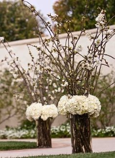 White hydrangea floral arrangement-to line the aisle during the ceremony or as large centerpiece for the reception.