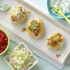 Hot Dog Sliders Recipe -An American favorite, hot dogs, turn into a fun treat that is great for a casual party. They get three special treatments in this recipe: Chicago-style, Bavarian and South of the Border.—Taste of Home Test Kitchen