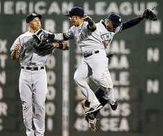 From left, New York Yankees outfielders Raul Ibanez, Nick Swisher and Curtis Granderson celebrate their 15-9 win in a baseball game against the Boston Red Sox in Boston, Saturday, April 21, 2012. (AP Photo/Michael Dwyer)
