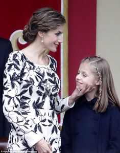 'Stop it, Mum!' Letizia looked the ultimate doting mother as she was joined by her picture-perfect family including Leonor, pictured, for Spain's National Day on Wednesday
