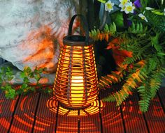 The Saturn lantern radiates a warm cosy flickering candlelight glow from it's single warm LED light. The panel and battery are integrated into a strong and durable unit which sits at the top of the 'rattan' cylinder. It has a AA rechargeable battery which is easily changed if need be.    Battery: 1 1.2V AA 500maH Ni-MH rechargeable battery  Panel : 2V 40maH Solar Panel  For residential decorative use, also good for children's night lights.  Automatic Day/Night Switch