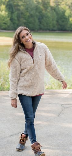 - 100% Polyester Sherpa Fabric, an embroidered cotton logo & accent color stitching and cuffs for functional (and comfortable) style. - With accented stitching, side vents & the comfiest polyester she
