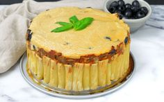 <p>This pasta pie is constructed with rigatoni, filled with creamy cashew cheese and marinara sauce, and studded with olives</p>