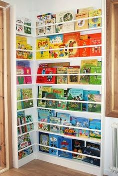 """Library Corner for a kids room...  As much as I like this, I have to admit I am a bit scared of the """"Creative"""" ways my children will reach the books on the top.  Still, cute though!"""