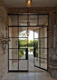 Double French doors with transom. 8 lite doors and 4 lite transom - Portella Doors Portella doors also makes great shower enclosures with cold rolled steel. Also make great interior steel doors, sliding doors ( kitchen cabinets? Industrial Door, Industrial Interiors, Vintage Industrial, Industrial Windows And Doors, Industrial Design, French Industrial Decor, Industrial Drawers, Industrial Closet, White Industrial