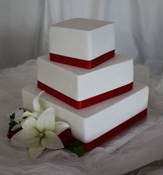 Simple wedding cake idea: square instead of round. the clean lines of this could be a nice balance to not using fondant