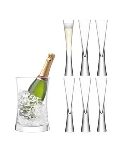 This sumptuous champagne serving set for six is suitable for grand celebrations and special gift occasions. The handmade champagne flutes have Moya's characteristically weighty stem and thick base. The mouthblown champagne bucket completes the set. Champagne Buckets, Champagne Glasses, Wine Bucket, Partys, Glass Design, Handmade, Base, Celebrations, Blown Glass