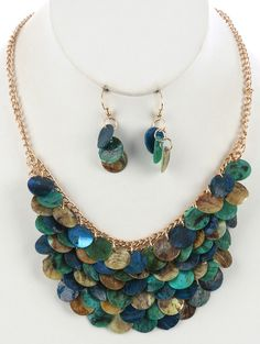 Arabella Ave by Tina  http://www.arabellaave.com/?a_aid=TinaGowans  BLUE & GREEN MULTI LAYER FISH SCALE BIB NECKLACE AND EARRING SET $14.95 ALSO AVAILABLE IN FALL COLORS, MULTI COMBO AND RED MULTI 16 INCHES LONG MULTI LAYER FISH SCALE BIB, OYSTER SHELL FINISH, LINK CHAIN FISH HOOK, 2 1/3 INCH DROP, NICKEL AND LEAD COMPLIANT