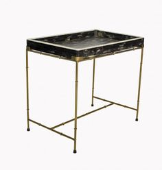 This great tray table is crafted from camel bone and brass plated frame. Tray does come off the base, for serving purposes. Tray measures 28.5