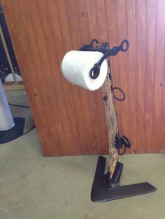 Plow hame and horse bit toilet paper holder. $50.00