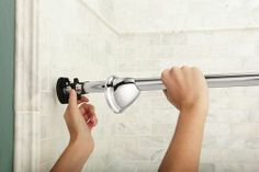 Moen has introduced a curved shower rod that's tension-mounted, so there's no need to drill holes in your walls. Shower Rods, Shower Curtain Rods, Tension Shower Rod, City Bathrooms, Home Helpers, Wall Lights, Ceiling Lights, Rv Living, Track Lighting