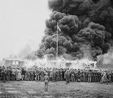 'Bergen-Belsen has become an imagined site, largely disconnected from the real place...' A crowd watches the destruction of the last camp hut.