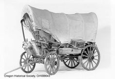 A covered wagon, like the one pioneers used to cross the Oregon Trail. Horse Wagon, Horse Drawn Wagon, Wooden Wagon, Old Wagons, Covered Wagon, Oregon Trail, Horse Carriage, Vacation Bible School, Western Theme