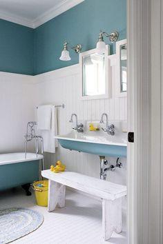 veranda interiors: Kohler Brockway // Teal Bathroom with clawfoot tub