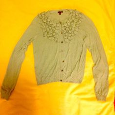 Ann Taylor Cardigan XS Never worn. Light sea foam green Ann Taylor Cardigan with flower detailing. Perfect condition except for one button that is a little loose- easily fixed with a stitch or two to tighten. Let me know if you have any questions! As always offers welcome! Ann Taylor Sweaters Cardigans