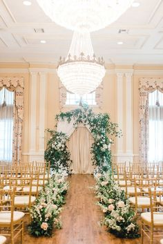 The golden ballroom of Arlington Hall made a beautiful ceremony and reception setting for Katie and Alan's wedding. We love the elegant floral arch by Moss Floral Design that did double duty as ceremony altar and a lovely backdrop for the reception!