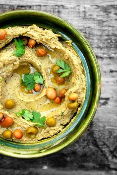 Hummus de Guandules - Gandules' Hummus hummus pigeon peas *   ingredient  500 grams of cooked pigeon peas  {150 grams of tahini sesame paste / sesame}  two cloves of minced garlic  juice of one lime {lemon}  half a glass of cold water  Fresh cilantro to taste {optional}  mild olive oil  and a little salt