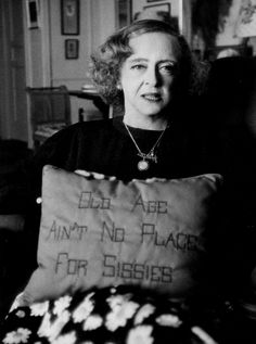 @Bette Davis A true powerhouse and trailblazer for women. Incredibly talented and outspoken. I love the saying on her pillow in this photo! #Old age ain't no place for sissies!