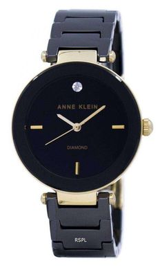 Features:  Gold Tone Metal Case Black Ceramic And Gold Tone Metal Bracelet Quartz Movement Mineral Crystal Black Dial Analog Display Diamond Marks At 12 O'clock Position Pull/Push Crown Jewelry Clasp 30M Water Resistance  Approximate Case Diameter: 30mm Approximate Case Thickness: 9mm
