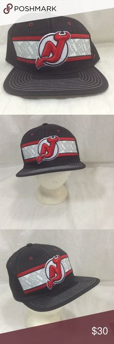 New Jersey Devils Hat SnapBack NHL Zephyr Cap New Jersey Devils Hat Sport:           Hockey League:       NHL Size:            Adjustable SnapBack  Condition:    Preowned Good  See all pictures Zephyr Accessories Hats