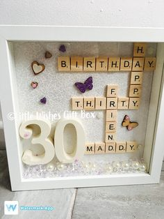 30th Birthday celebration photo box frame. Can be made for any age & in any colours. Message me with the words youd like added. Frame measures 25cm x 25cm x 4.5cm in depth. Made with quality wooden numbers & scrabble letters. Your box frame will be white unless instructed