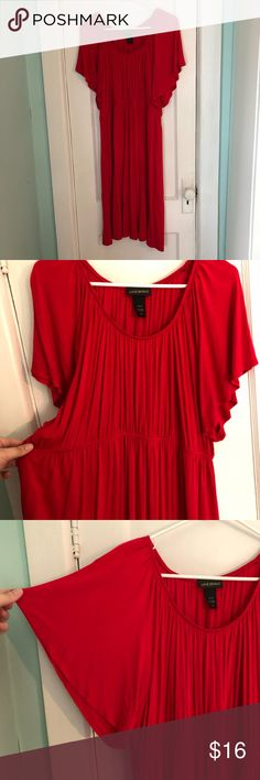 Red Dress with Elastic Waist Very comfortable red dress. Elastic waist and flutter sleeves. 95% Rayon. 5 % Spandex. Home is smoke free and cat friendly. Lane Bryant Dresses