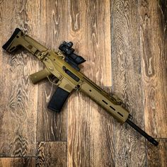 Bushmaster ACR w/Trijicon ACOGLoading that magazine is a pain! Get your Magazine speedloader today! http://www.amazon.com/shops/raeind