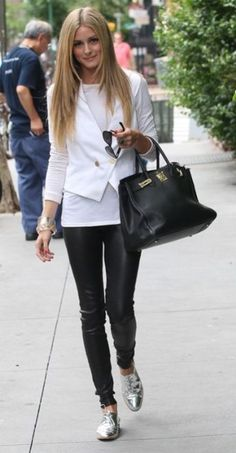 Olivia Palermo: black leather pants & bag - white shirt & jacket - silver & plastic bracelets- red nail polish