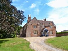This detached, Grade ll listed, 17th-century Tudor brick house is an ideal place for a family holiday or a short break with friends.