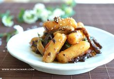 Did you know that this non spicy Rice Cake Stir Fry with Soy Sauce (궁중떡볶이 Goongjoong Ddukbokki/tteokbokki) has been around much longer than the more common red spicy version?  The name Goongjoong/g...