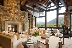 Contemporary Living Room with MS International Mokoro Granite, Manor Stone Stick On Cladding, Hardwood floors, Exposed beam