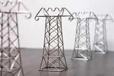 make all your home power lines stylish with these pylons. designer Daniel Ballou was inspired by the Power lines in California when he designed these genious Home Gadgets, Desk Gadgets, Fun Gadgets, Iron Wire, Cable Organizer, Small Apartment Decorating, Digital Trends, Train Layouts, Woodworking