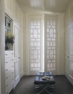 fretwork on doors to walk-in closet