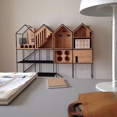"""Shaped like houses, a dinnerware storage cabinet, named after the Thai word for """"home,"""" exudes warmth and good cheer while presenting the perfect place for everything."""