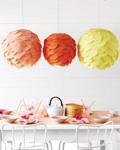 These decorations really layer on the style. Any pale-colored paper lantern can be covered with tissue circles (buy them precut -- no scissors required) for a charming fluttery finish.