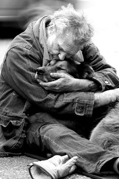 This picture is proof positive that there is a special kind of love between man and dog, regardless of circumstance