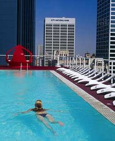 "Rooftop Pool, The Standard Downtown (Los Angeles). ""André Balazs's über-cool hotel takes the urban swimming pool to another level—namely, the 12th-floor rooftop. The glowing L-shaped pool, rimmed by funky space-age cabanas with vibrating waterbeds, has a lively cocktail lounge to the side, which attracts wide-eyed tourists and local hipsters. They come as much for the drinks and music as the spectacular views of Library Tower, Museum Square, and the rest of the city's glittering skyline."""