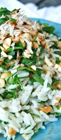 The BEST Coconut Rice. This isn't your average coconut rice. First the rice is cooked in coconut milk then it's loaded with shredded coconut, fresh cilantro and chopped peanuts. So, So, So Delcious!!!