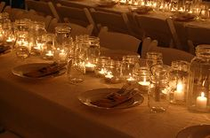 A very pretty and fairly inexpensive table setting for a rustic wedding.  Maybe with some Daisies in Jars as well.