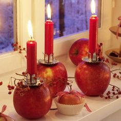 DIY CANDLE HOLDERS Pomegranates/Apples with holder's inserted into them.....Really like this plus....Thanksgiving Decor Ideas: centerpieces, table settings, fall wreaths and more! | Just Imagine