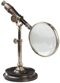 Bronzed magnifier with stand. This classic magnifier with stand is made of duotone bronzed brass and wood. Heavyweight stand allows free use of hands. Magnifier with stand is a classic gift for any executive. Vintage Home Offices, Lupe, Entryway Console, Bodo, Magnifying Glass, Dot And Bo, Home Office Decor, Office Desk, Corporate Gifts