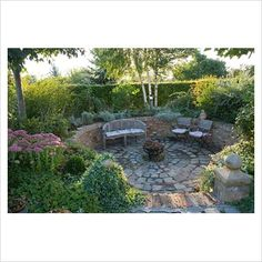 sunken patio with mixture of plantings. Backdrop needs to provide shelter and privacy