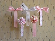 Fancy Clothes Pins  All you need are wooden clothes pins, decorative paper, ribbon, embellishments of your choice, hot glue gun and scissors  For directions: icingdesignsonline.blogspot.com  Etsy   icingdesigns