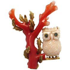 Impressive Coral Sapphire Owl Gold Brooch Pin 14k gold brooch adorned with red and angel skin coral, which depicts an owl with sapphire eyes sitting on a branch. The piece measures 60mm x 44mm and weighs 22 grams. $1,800.00