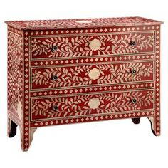 """Hand-painted cabinet with a red and off-white floral motif and 3 drawers.   Product: CabinetConstruction Material: Engineered woodColor: Red and off-whiteFeatures:  Hand-paintedThree drawers Dimensions: 34.75"""" H x 41.5"""" W x 18.5"""" D"""