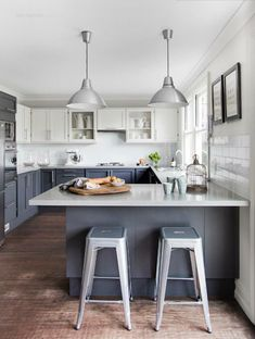 Love the light shades! {kitchen | Est Magazine} little lighter gray on bottom but like dark on bottom and light on top cupboards.