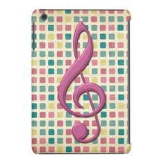 A stylish and chic iPad Mini Retina Display case with a musical design featuring a large pink treble clef on a geometric mosaic pattern background in shades of pink, teal and yellow. Please note the satin raised effect of the treble clef is a printed effect, there are no raised edges on the image design.