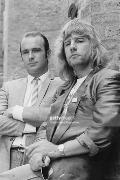 English musicians Francis Rossi (left) and Rick Parfitt of rock group Status Quo posed together at London Bridge in London on 19th May 1986.