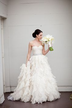 this dress is amazing. the bride looks beautiful. from style me pretty